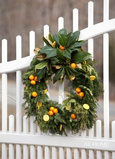 purchased wreath studded with kumquats, lemons, cedar & magnolia