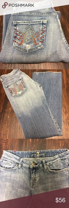 7 for all mankind jeans 26 7 for all mankind jeans with Caribbean crystals on the pockets size 26 inseam is 31 and waist is 14 across laying flat 7 For All Mankind Jeans Flare & Wide Leg