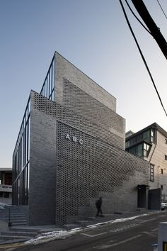 Perforated brick walls front this seoul office block. Brick Architecture, Architecture Office, Architecture Details, Office Buildings, Brick Design, Facade Design, Exterior Design, Building Facade, Building Design