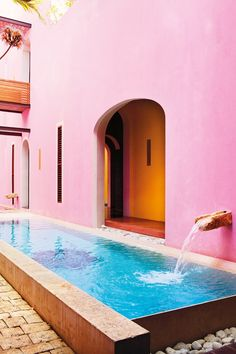 A bubblegum pink exterior contrasts with the cool blue water of the plunge pool at the fabulous Mexican retreat.