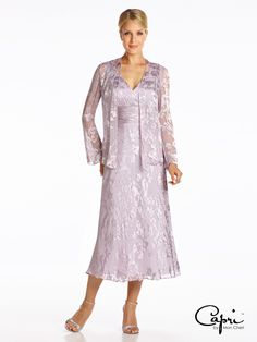 Two-piece vine silk burnout dress set, sleeveless ballerina-length A-line dress with front and back V-necklines, surplus bodice, ruched natural waistband, matching long sleeve jacket with hand-beaded trim included. Sizes: 4 – 20, 16W – 26W Colors: Lavender, Blue