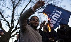 A protester burns a Drumpf campaign flag outside the venue.