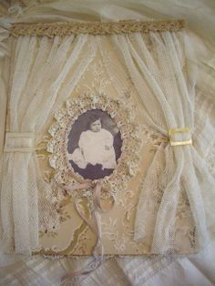 "Love this work - vintage photo, mat is understated patterned fabric, outlined with ribbon-trimmed lace and curtained in gauzy fabric (might like something slightly less net-like) - this piece is gorgeous! Wonderful inspiration! *********************************************   by skblanks, via Flickr - #vintage #photo #frame  page for Karla's book for ""Her Life in Stitches"", via Flickr."
