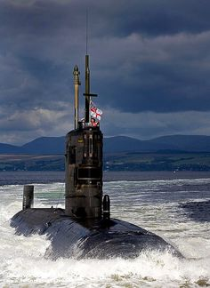 Photograph shows the Fleet SSN HMS Tireless transiting the Clyde estuary on her way to sea after a short period alongside at HMNB Clyde.