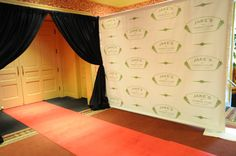 """so great at entrance like a Hollywood event! the phtographer can be at the door to take the pics(instead of the photobooth)  the logo of the card can act as """"sponsor"""" logo on background"""