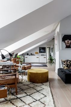 This cozy Scandinavian-style apartment is located on Åsögatan, in Södermalm, a district and island in central Stockholm, Sweden. Its interior, covering a total area of 180 square meters, was completely renovated in 2014, and the result is absolutely stunning. The frontal part of the apartment has an open plan, which allows for a general appreciation of the entire space at first entry. And what a space – clear white inclined..