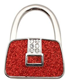 This chic purse hook ensures handbags are safe, sanitary and stylish too. Placed atop any ledge, this necessity keeps belongings off the floor, within arm's reach and in eyesight. When not in use, it acts as a purse charm and key ring, adding a pretty pop of panache to arm candy.2.75'' W x2.25'' HMetalImported