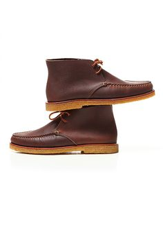 Monhegan Moccasin Chukka Boots by Eastland of Maine - Wood colored moccasin chukka boots with square leather laces through two blind eyelets. Waxy contrast stitching at toe. Featuring a 360 double welt brown leather midsole with a natural crepe rubber sole for flexibility, traction, and comfort.     Handcrafted in Maine, U.S.A., since 1955.     These loafers are bench made using genuine true moccasin construction, meaning the leather from the upper fully wraps under the wearer's foot. This…