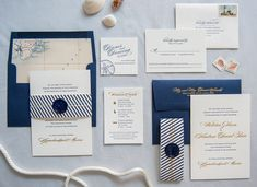 Want to take your nautical theme up a notch? Go a little more formal by using elegant extras like envelopes lined with map prints and letterpress embossing.