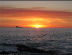 pretty orange sunset glowing sun | ship in the distance by Iv�n P�rez | openphoto.net (BETA)
