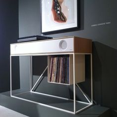stereo console by Symbol Audio connects to a record player or Bluetooth-enabled device. Plus there's a place to store your records!