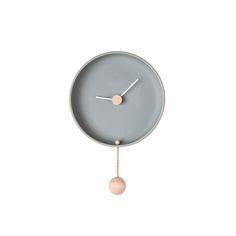 Wall clock in ceramic and beech wood.