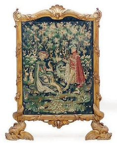A FRENCH GILTWOOD AND MACHINE-WOVEN TAPESTRY FIRESCREEN,