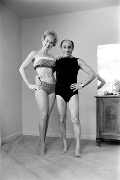 Alfred Eisenstaedt poses with beauty culturist and the first woman to star in her own daily exercise TV show, Debbie Drake, 1962.