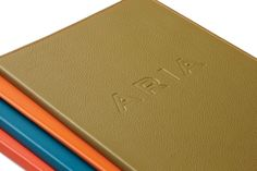 Leather bound menus for restaurant Aria designed by Frost.