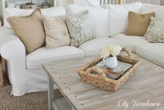 Love my white slipcovered furniture! So easy! Just throw slipcover in the wash & voila! Like new again....even with 2 little boys, 2 dogs & a cat!