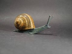 Enamelled Garden Snail Louis Lejeune Ltd. Recent and archive photos of standard and bespoke car mascot/ hood ornament commissions.