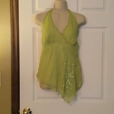 Studio Y halter top Lime green halter top with tie at neck.  Elastic at lower back.  One side is longer than the other with sequins on front.  Has lining inside.  100% polyester  and lining is 100$ polyester also.   Very soft. Studio Y Tops Blouses
