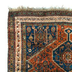 """- Fine, hand knotted, antique rug - Geometric pattern with red, orange and dark teal overtones - Good condition overall, slight wear on fringe Dimensions: 5'5"""" W x 7'L"""