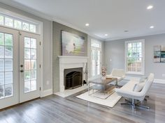 Transitional Living Room with Cement fireplace, Carpet, Crown molding, Hardwood floors, High ceiling