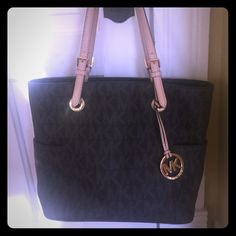 Authentic Michael Kors Purse Like new!  No flaws. Gently used.  Many pockets inside with a center zip up pocket as well. It's a great purse this isnt too big but large enough to carry everything you need easily!  Looks great with jeans or nice enough to wear with dress clothes.  It was a gift and I like smaller purses. It's dark brown with tan straps and gold hardware. Michael Kors Bags Totes