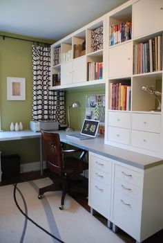 "IKEA home office  Source list:    Cabinetry: IKEA  2 Expedit bookcases  4 Expedit drawer inserts  4 Expedit door inserts  2 Mikael drawer units  1 Benno CD tower  8 - Numerar 4 3/8"" legs  1- Galant leg  2 Numerar countertops:aluminum/white (96"" long and 73"" long)      Curtains: Gunvor fabric from IKEA    Paint: Brookside Moss 2145-30 by Benjamin Moore    Rug: IKEA"