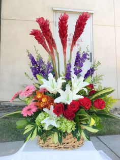 tall red ginger flowers, lilies, red roses, cymbidium, gerberra daisies