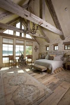 Antique beams in the white rustic cabin bedroom