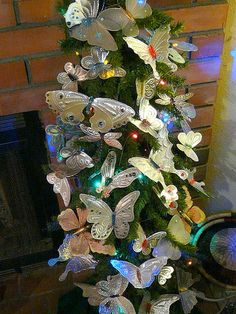 Perfect addition to any winter garden to bring things back to life. Punched Tin Butterflies massing on my Seasonal Tree by gingerbread_snowflakes, via Flickr
