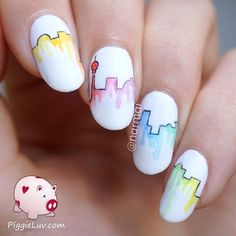 Comic themed watercolor nail art design. With only using white as your base color and a minimum amount of watercolor design, you can achieve eths rather simplistic but fun looking comic inspired nail art design.