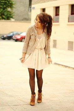 sweater layered over a dress.