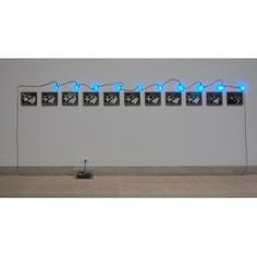 Mario Merz, Fibonacci 1202, 1970, eleven black-and-white framed photographs, ten neon signs, and one transformer, Dallas Museum of Art, fractional gift of The Rachofsky Collection