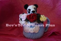 Little Timmy - Crocheted, 5 inch tall Panda Bear with moveable arms and legs.  He lives  in a Crocheted Mug with 3 crocheted roses!