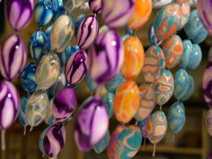 https://flic.kr/p/aZMT5   polymer clay, March 2006   Glazed beads hanging to dry.