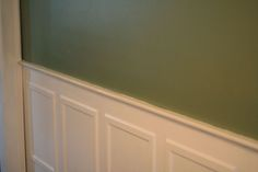 Sage green walls with white picture frame moulding