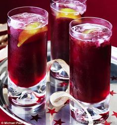 Cranberry Cooler - Will light up any holiday gathering. 18 fl oz chilled cranberry juice ,18 fl oz chilled red grape juice ,18 fl oz chilled ginger ale ,1 large lime cut into 6 wedges. Also can add a dash of Vodka to spice thing up :)