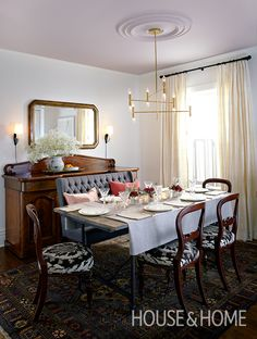 In editor-in-chief Beth Hitchcock's formal dining area, the delicate pink ceiling softens the look of the room and provides a subtle contrast against crisp white walls.   Photographer: Michael Graydon   Designer: Sarah Hartill and Stacey Smithers