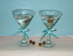 Tiffany Blue Wedding Decoration / Martini by CarolesWeddingWhimsy, set of 2, Aqua Blue and Pearl Martini Glasses - These are perfect for a Bachelorette Party, Bridal Shower or for the Martini Loving Couple - Martini Lover Wedding Toasting Glasses.  They are embellished with pearl.   You can find them here https://www.etsy.com/listing/129316611/tiffany-blue-wedding-decoration-martini