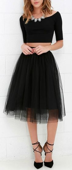 Black midi skirt. Black tank top with sleeves and black leather shoes. Inspiration. Statement necklace.