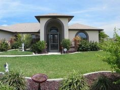 Professional landscaping and curb appeal that cant be beat. Lots of room and a great open floor plan located in NW Cape Coral minutes away from shopping and restaurants. Step into the large screened front porch and with double glass entry doors and youll feel right at home. The home is light and bright with high ceilings and plant shelves. Plenty of room for entertaining in the formal living and dining room and a family room too. The well appointed kitchen offers stylish maple cabinets and…