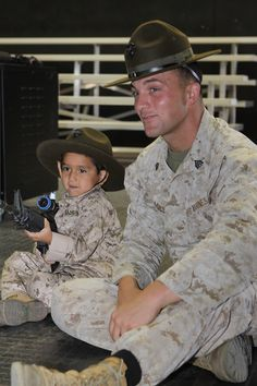 Jorge Solis, 5, gets a rifle shooting lesson from Sgt. Daniel Mullis, a formal marksmanship training course instructor at the Individual Simulated Marksmanship Trainer here, Aug. 10. Solis, who suffers from retinoblastoma, a rare type of eye cancer, got the chance to live his dream when the Make-A-Wish Foundation of Orange County and the Inland Empire partnered with Camp Pendleton to conduct a hands-on tour for Jorge and his family, Aug. 10.
