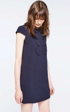 Love the Sixties inspired cut and the front detail