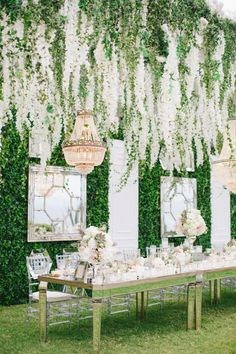 elaborate reception display with hanging florals and mirrors   Photography: Anna Roussos