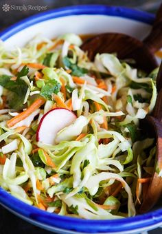 Southwestern Coleslaw ~ Thinly sliced cabbage, carrots, radishes, green onion, and cilantro, tossed with olive oil and rice vinegar dressing. Great for TexMex and Southwestern dishes. ~ SimplyRecipes.com