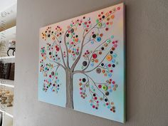 "Vibrant Button Tree on Canvas I see this in my very near ""crafts to try"" future!  Read that if your buttons have the attachment loops on the back to make a small hole in the canvas for the loop to fit into before gluing into place!  Wondered how to use those!!!"