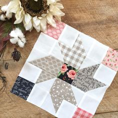 fabric called Farmers Daughter. The quilt is made of 4 blocks measuring 10″ and some fun sashing.