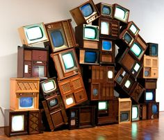 Nam June Paik- Ruin, 2001, 32 antique TV cabinets and 2-channel video on DVDs Image source: Jonathan Lurie See more Nam June Paik postshere.