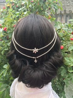 Silver toned diamante drapes with a diamante flower and leaves add sophisticated bling to your bridal style. Small combs embellished with diamante pieces on each side hold the headpiece in place. This hair chain could be worn to complete a traditional, classic or vintage look.  You can see all my other pretty creations at:  https://www.etsy.com/uk/shop/CamillaCarrington  Your purchase will arrive beautifully packaged.  Thank you for visiting my shop  Camilla x