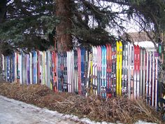 Ski fence in Bozeman,Mt - got to look for used skis. Love this idea.