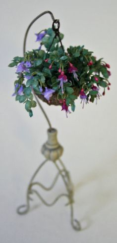 1:12 miniature Fuchias hanging on ornate metal stand. Made from handmade papers and silk covered wire, 11cm high